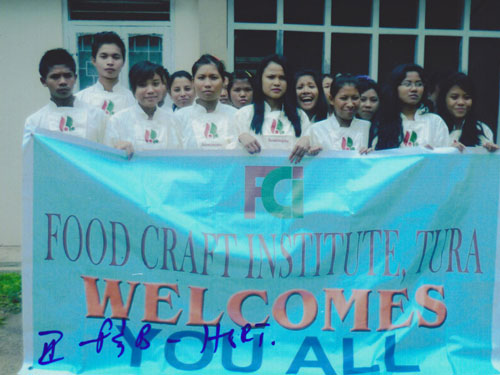 Holding a banner of food craft institute, Tura