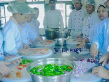 Students are chopping vegetables