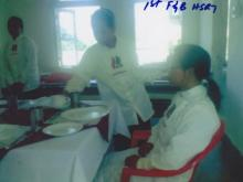 Student is sitting to test a food