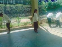 Girls are cleaning the garden