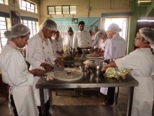 Students are Practising to chop vegetables