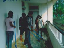 Students are cleaning the Corridor